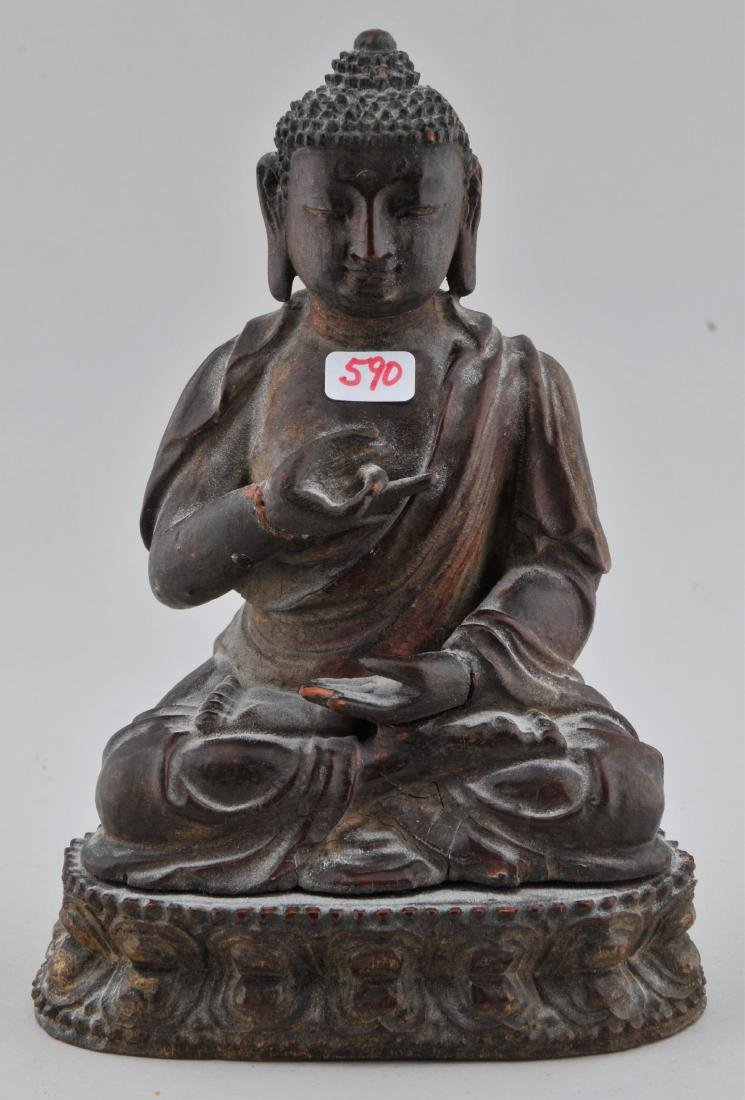 Carved wooden Buddha. China. 18th/19th century. Seated
