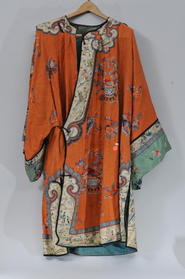 Woman's robe. China. Circa 1920. Orange ground with