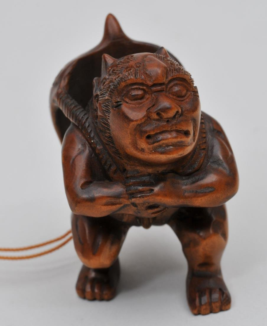 Wooden Netsuke. Japan. 20th century. Demon with a demon