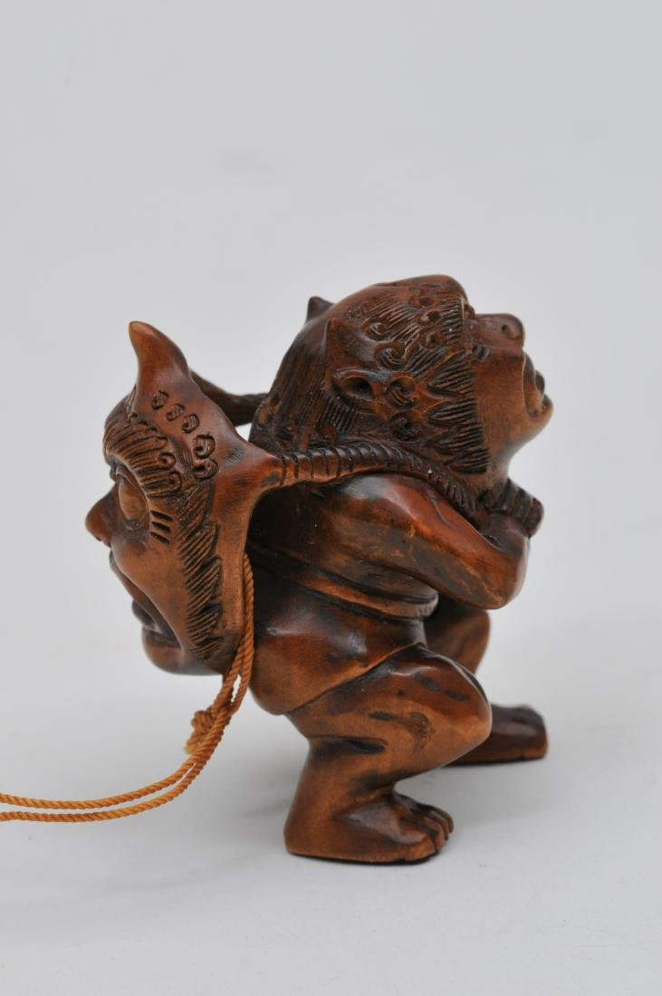 Wooden Netsuke. Japan. 20th century. Demon with a demon - 2
