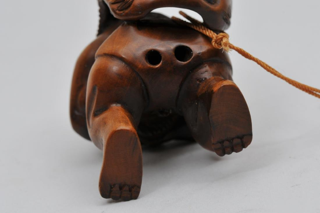 Wooden Netsuke. Japan. 20th century. Demon with a demon - 5