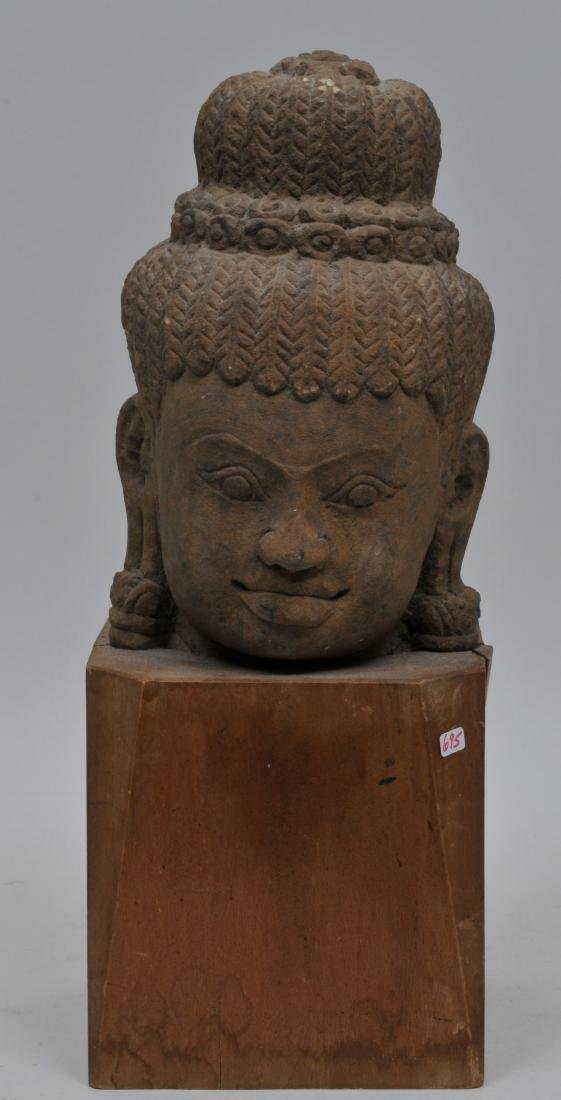 Carved red sandstone head. Khmer. 13th century. Wooden