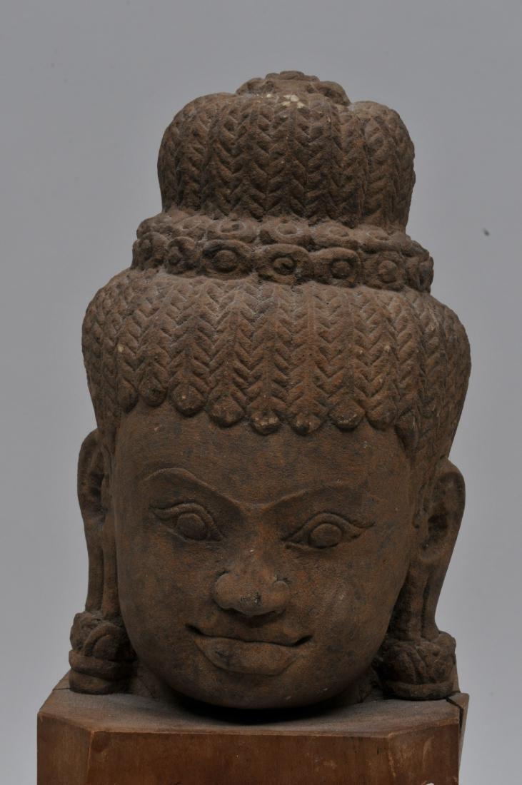 Carved red sandstone head. Khmer. 13th century. Wooden - 2
