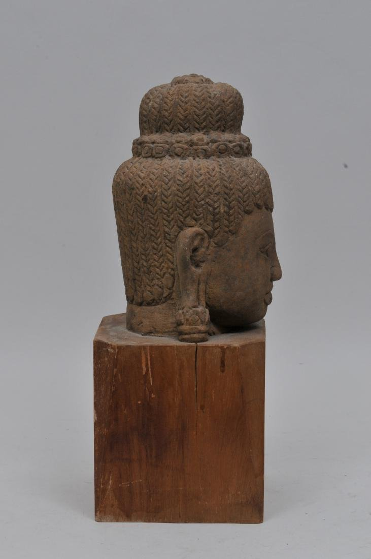 Carved red sandstone head. Khmer. 13th century. Wooden - 3