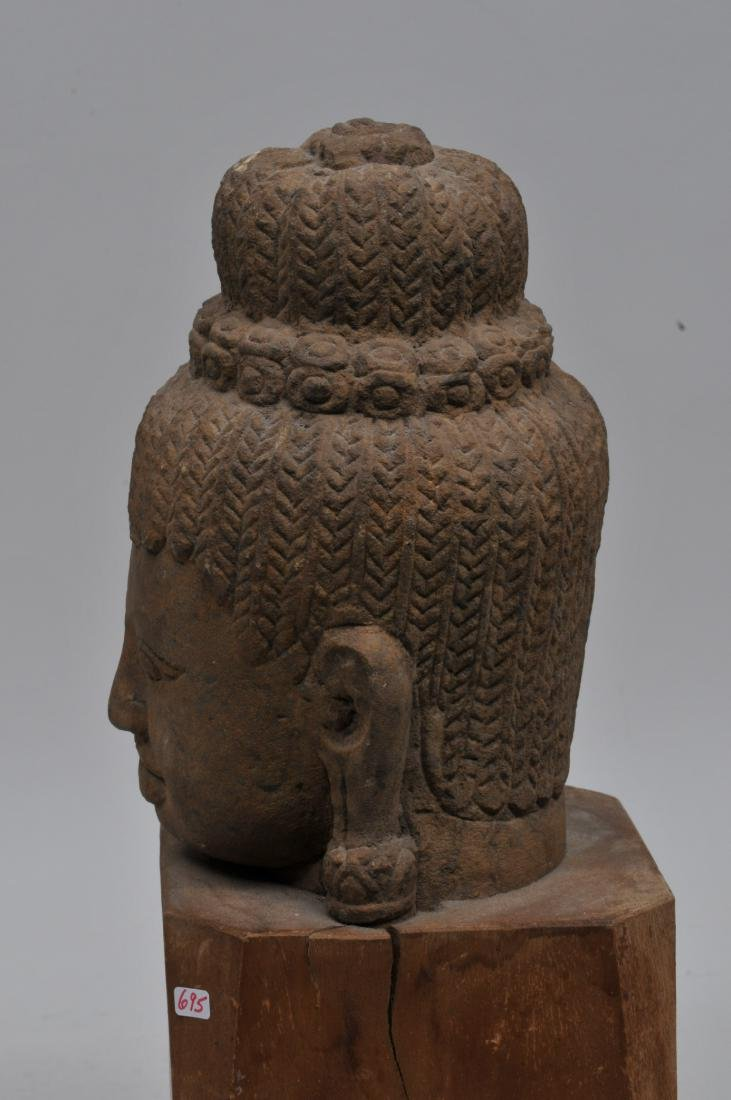Carved red sandstone head. Khmer. 13th century. Wooden - 5