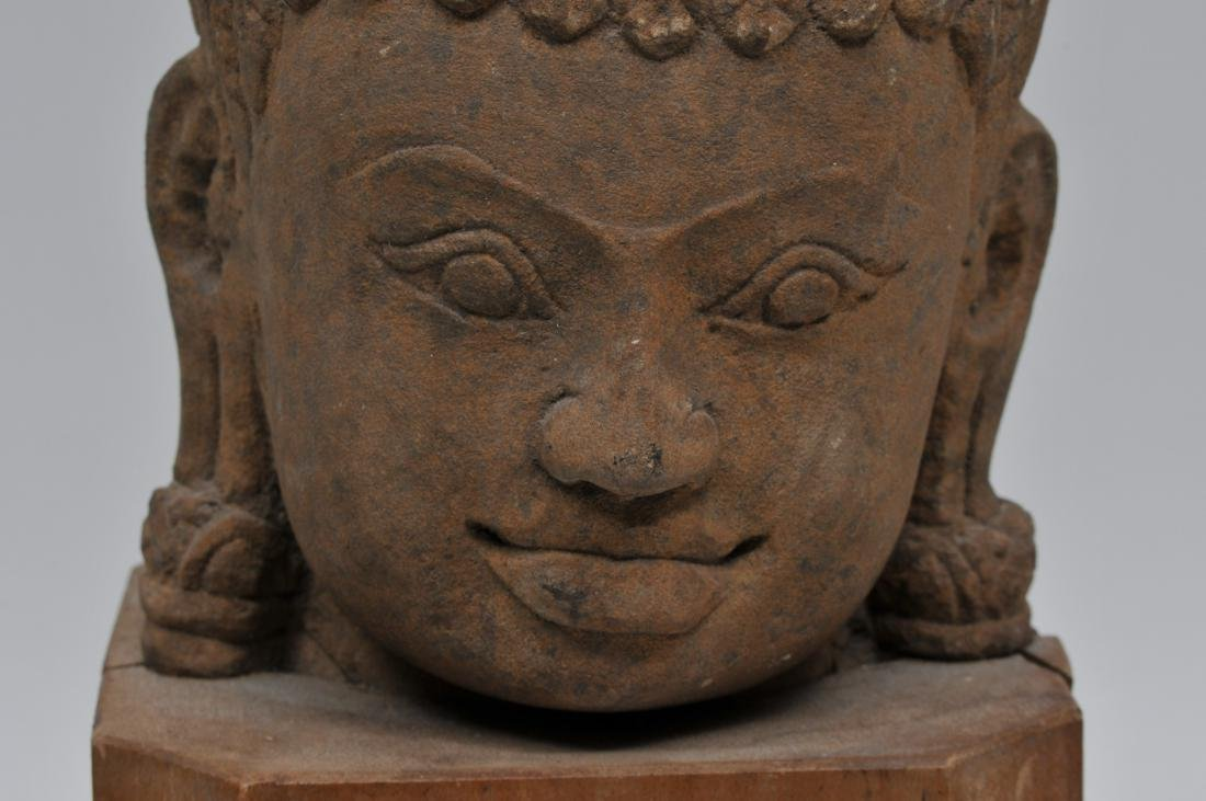 Carved red sandstone head. Khmer. 13th century. Wooden - 7