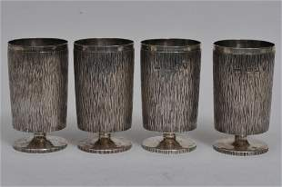 Four Gerald Benney English silver heavy bark decorated