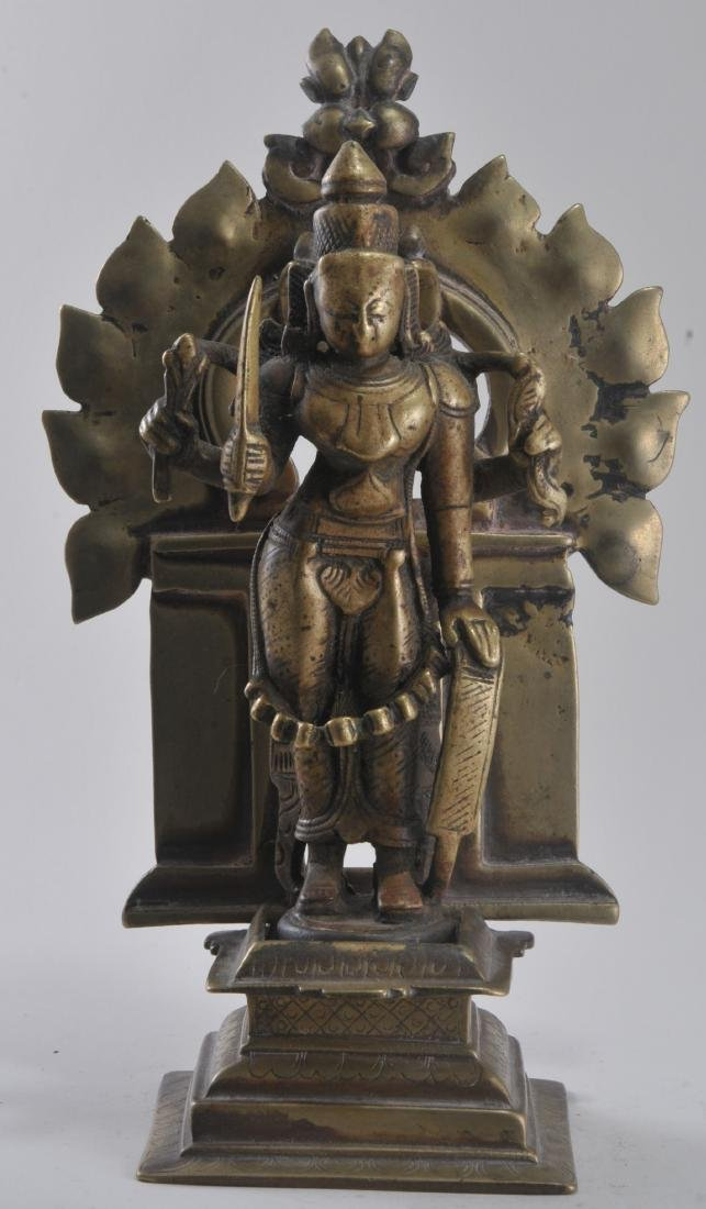 Bronze image. India. 15th century. Enthroned image of
