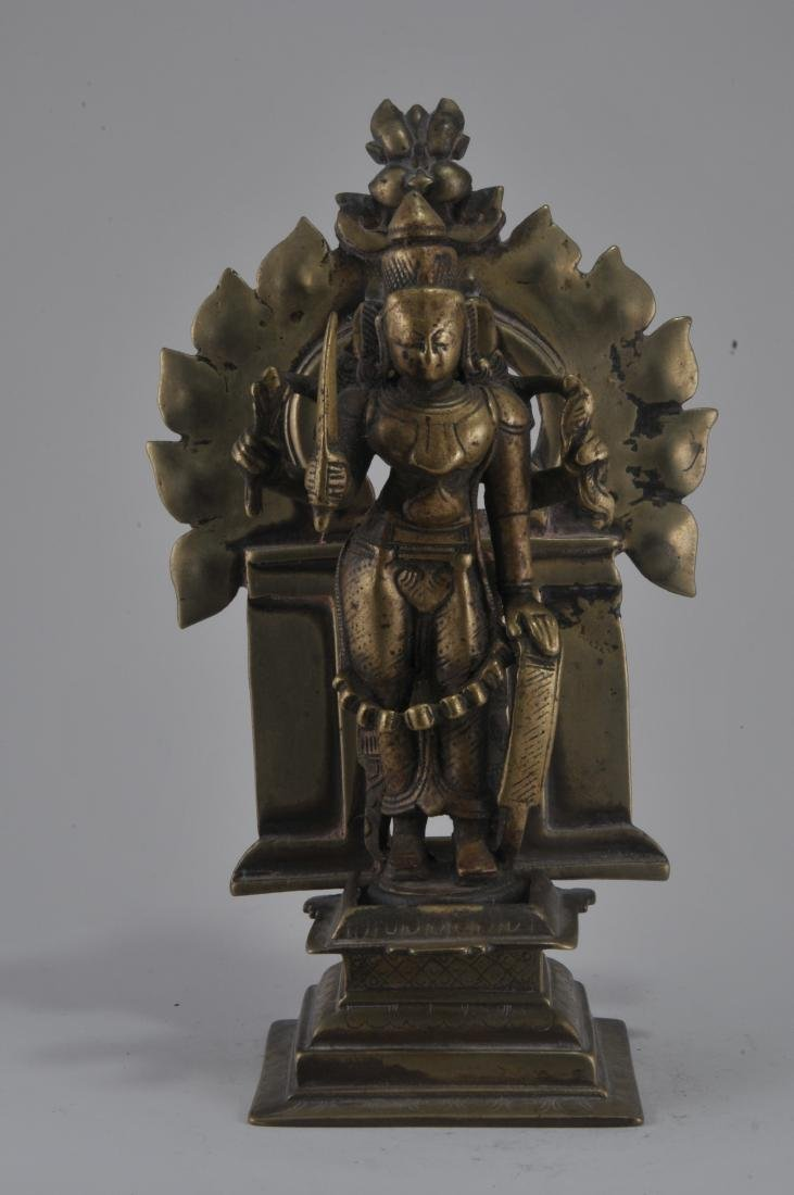 Bronze image. India. 15th century. Enthroned image of - 2