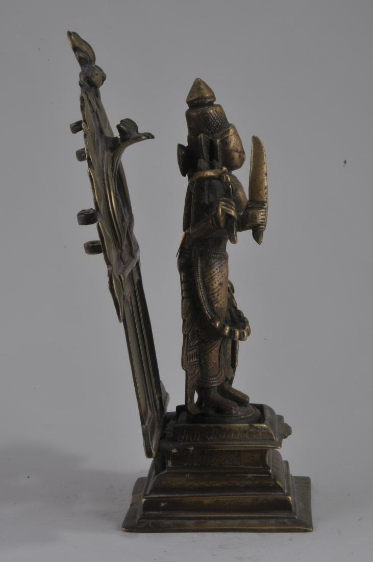 Bronze image. India. 15th century. Enthroned image of - 4
