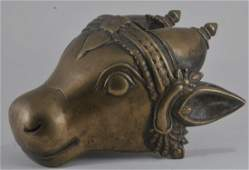 Bronze votive head. India. 17th century. Figure of