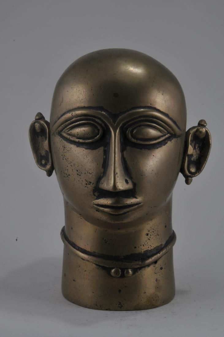Bronze votive offering. India. 18th century. Head of a