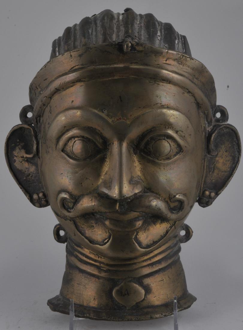 Bronze votive mask. India. 18th century. Male visage.