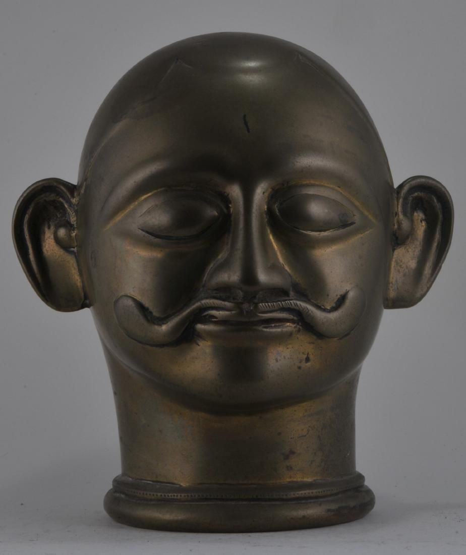 Bronze votive head. India. 18th century. Male figures.