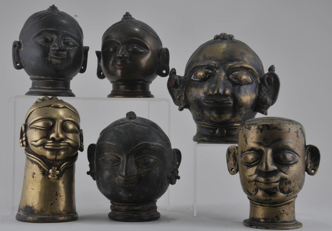 Lot of six bronze votive heads. India. 17th century.