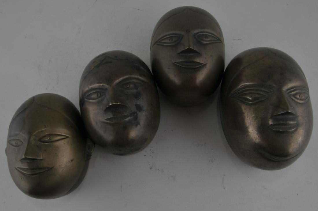 Four bronze boxes. India. 19th century. Shaped in the