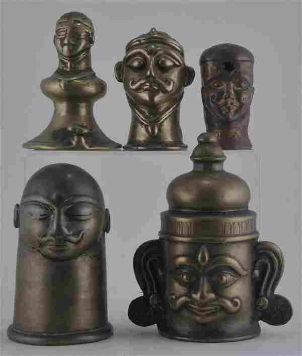 Five bronze male votive heads. India. 17th century.
