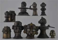 Lot of ten bronze votive heads India 19th century