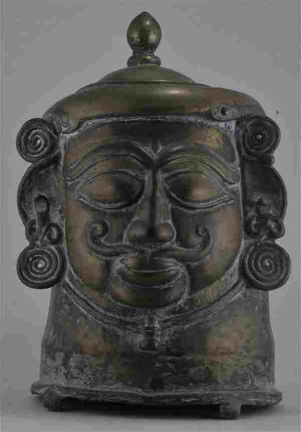 "Votive bronze head. India. 18th century. 12-1/2"" high."