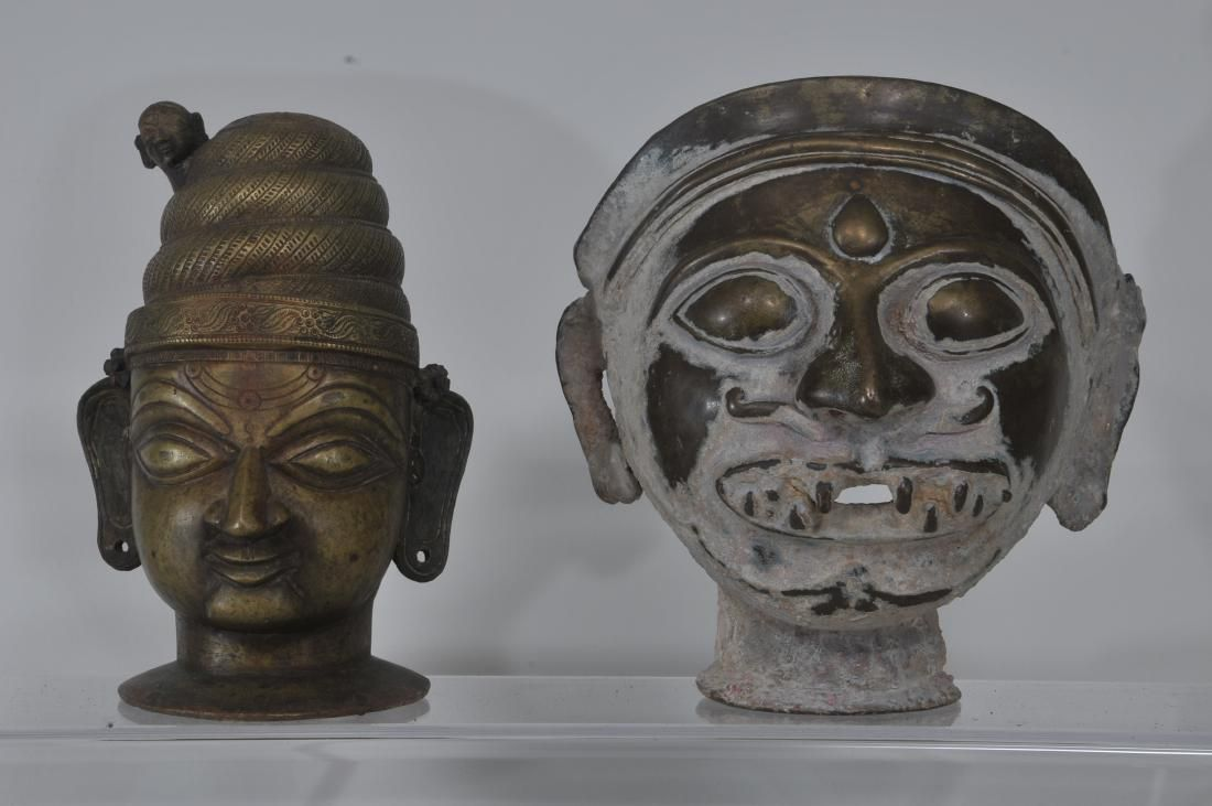 Two bronze votive heads. India. 19th century and
