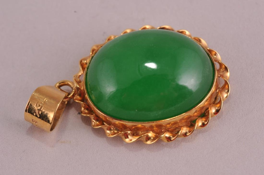 Jade cabochon pendant with 18 karat gold setting.  Jade - 2