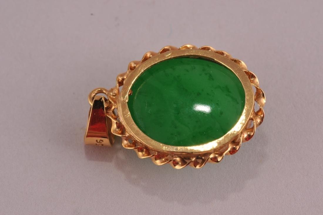 Jade cabochon pendant with 18 karat gold setting.  Jade - 3