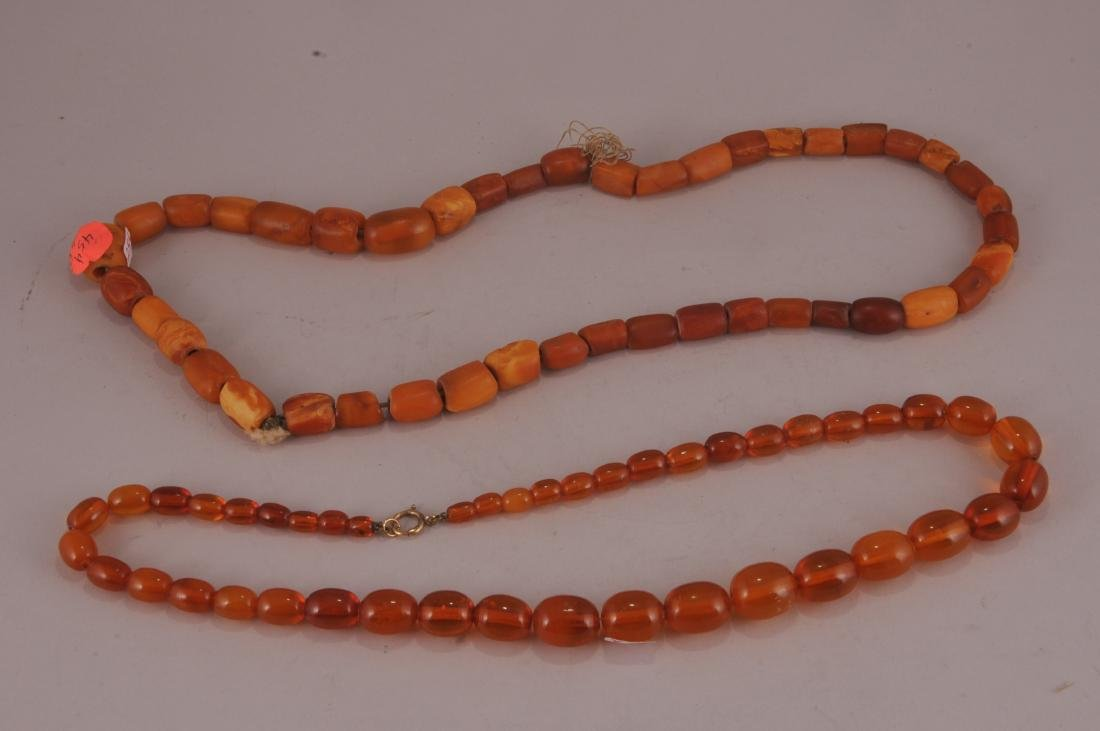 Two amber necklaces. Butter scotch colour. One with a