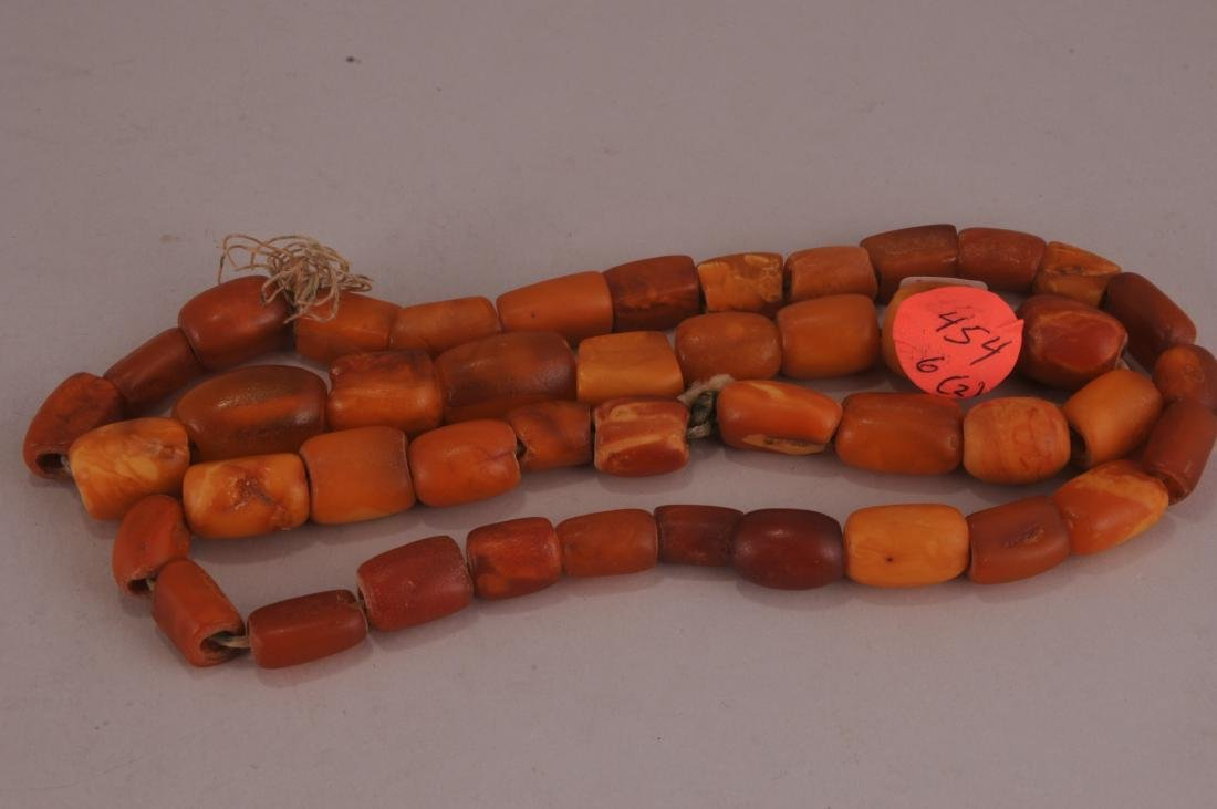 Two amber necklaces. Butter scotch colour. One with a - 3