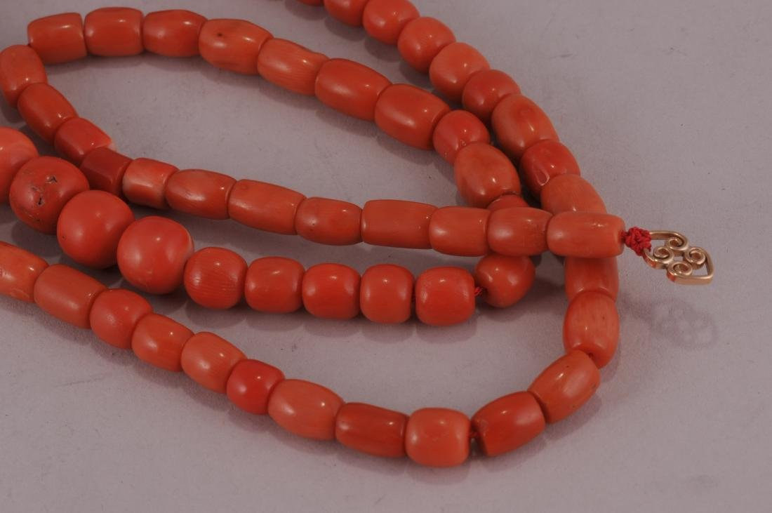 """Set of coral beads. 14 kt clasp.  Deep colour. 23"""" bead - 4"""