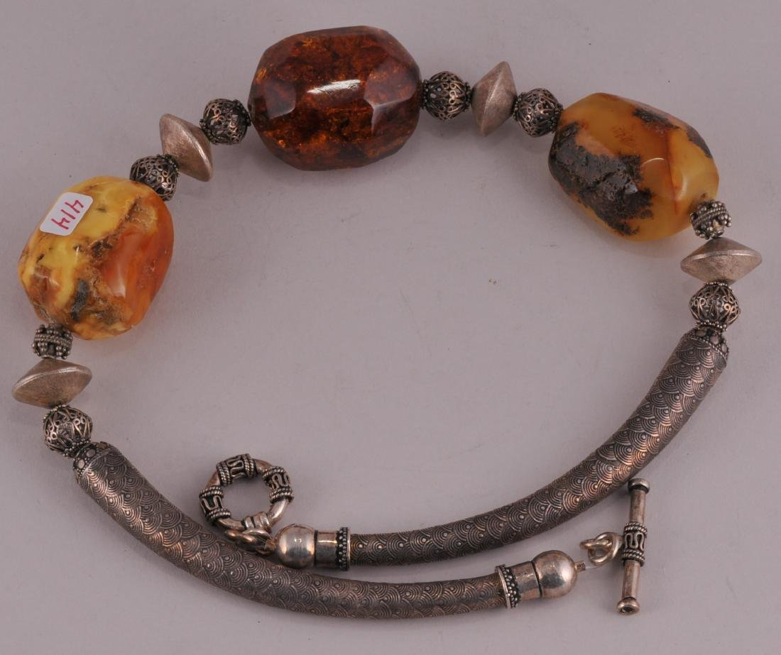 Asian sterling silver and large faceted Amber nugget