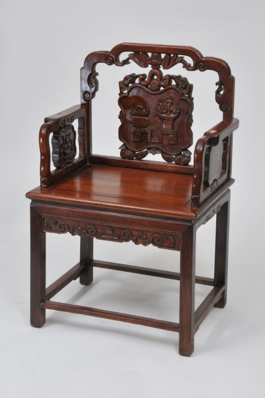 Rosewood  chair. China. 19th century. Surfaces carved w