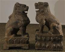 Pair of guardian lions China 19th C Carved stone 21