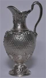 Ornate Scottish Victorian sterling silver ewer. Allover