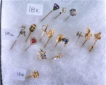 Lot of stickpins. One platinum and 18k with amethyst