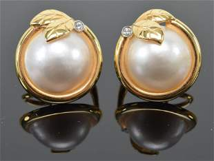 Pair of 14K gold and mabe pearl earrings. Pearls are