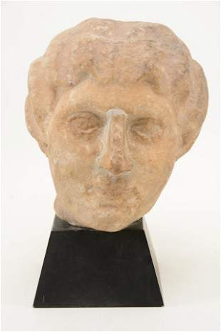 Lifesize Roman antiquity carved marble head of a woman.