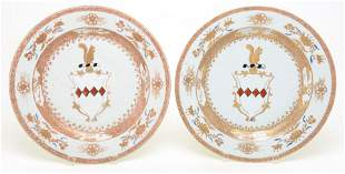 Pair of Chinese export armorial porcelain chargers