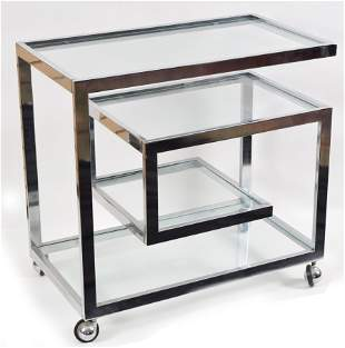 Mid Century Modern chrome and glass rolling bar cart.