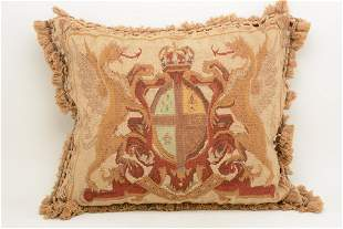 Needlepoint upholstered down pillow with armorial
