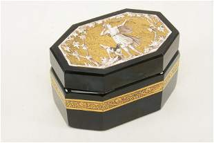 Octagonal black glass covered box with relief enamel