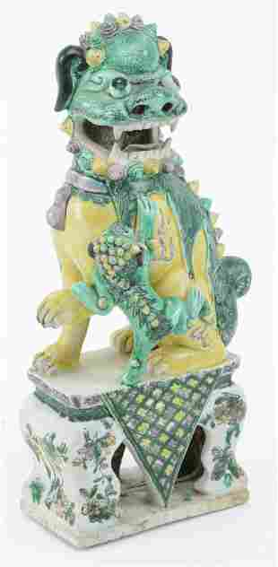 Porcelain foo dog. China. 19th century. San Tsai glaze