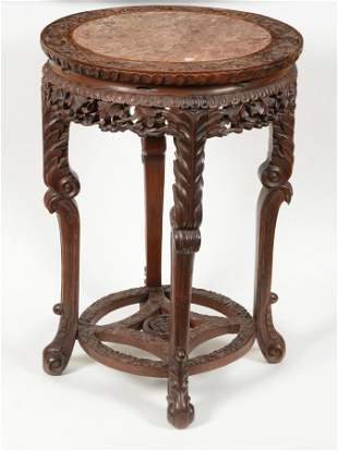 Occasional table. China. 19th century. Carved rosewood.