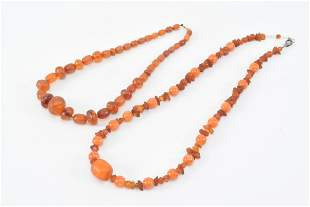 Lot of 2 amber necklaces.