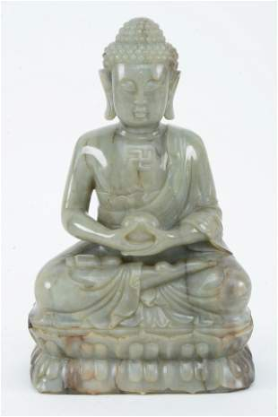 Jade carving. China. 20th century. Grey stone with