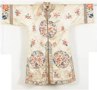 Embroidered robe. China. 20th century. Pale yellow