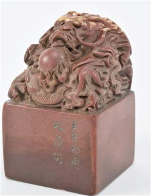 Red soapstone seal. China. 20th century. Dragon finial.