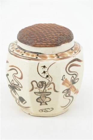 Stoneware jar. China. 19th century. Octagonal form. Tzu