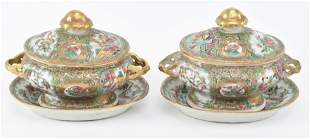 Pair of porcelain service dishes with covers and trays.