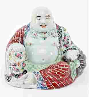 Porcelain buddha. China. Early 20th century. Seated