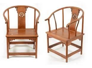 Pair of rosewood yoke back chairs. China. 20th century.